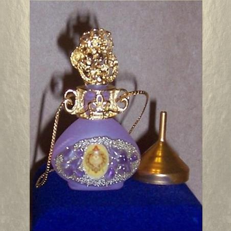 Collier fiole à parfum plaqué or dans écrin modèle 37