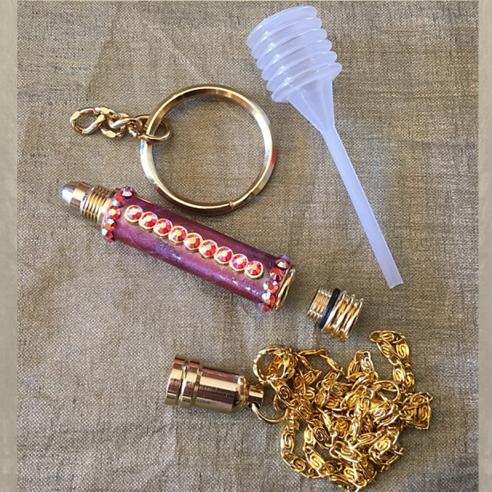 Roll on stylo bille applicateur de parfum Cristal de Swarovski couleur caméléon monté collier ou porte clé ouvert. 2